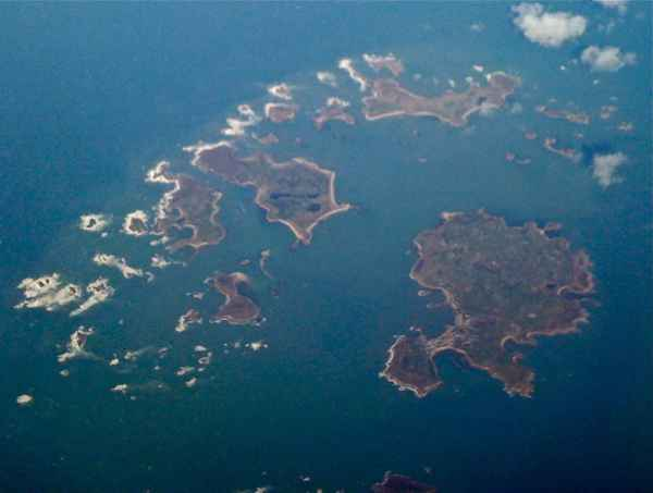 The Isles of Scilly as seen from the air. All of the water between the islands on the left and most of the water between them and St. Mary's, the large island on the lower right, was dry land as late as 500 AD. Photo by Mike Knell, taken in March 2009, and made available under a Creative Commons Attribution-Share Alike Generic 2.0 License.